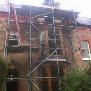 old house with scaffolding